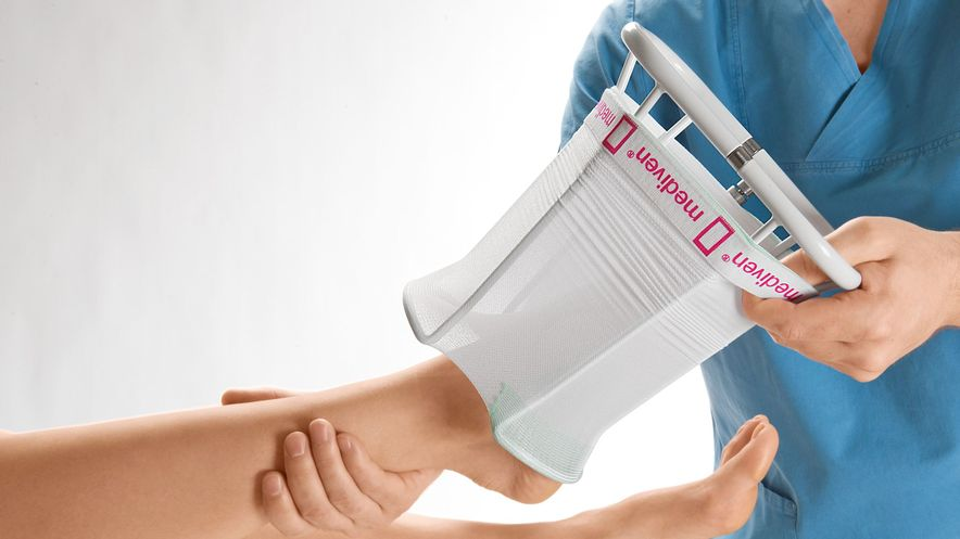 Donning compression stockings with medi Hospitalbutler, step 3