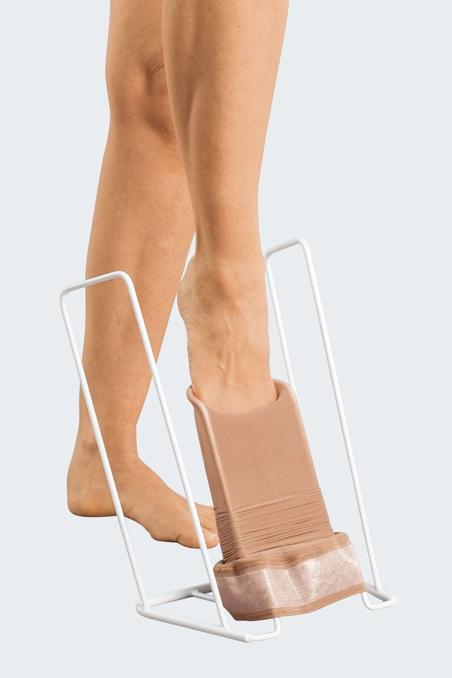 Donning compression stockings with medi Butler, step 3