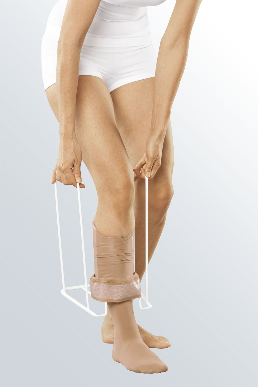 Donning compression stockings with medi Butler, step 5
