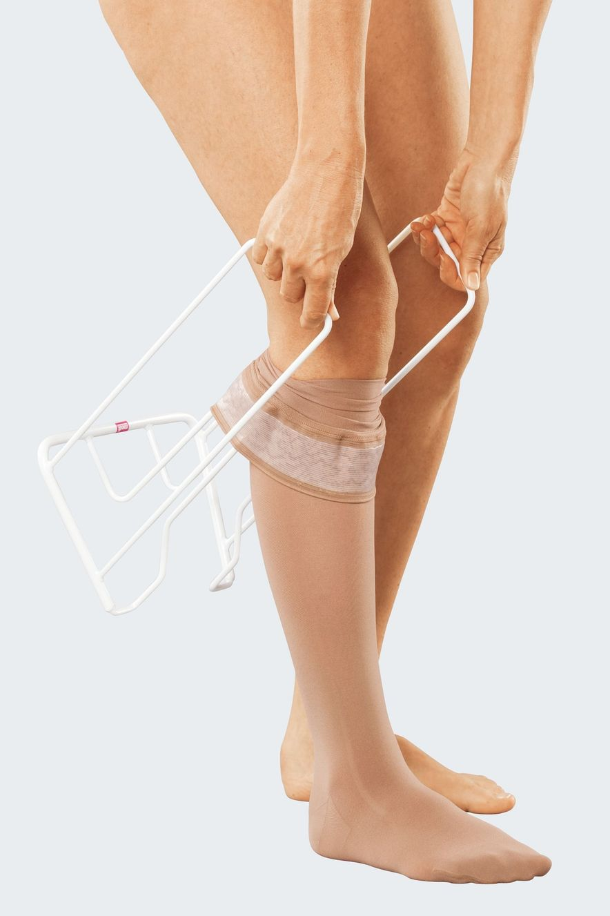 Donning compression stockings with medi Butler, step 6
