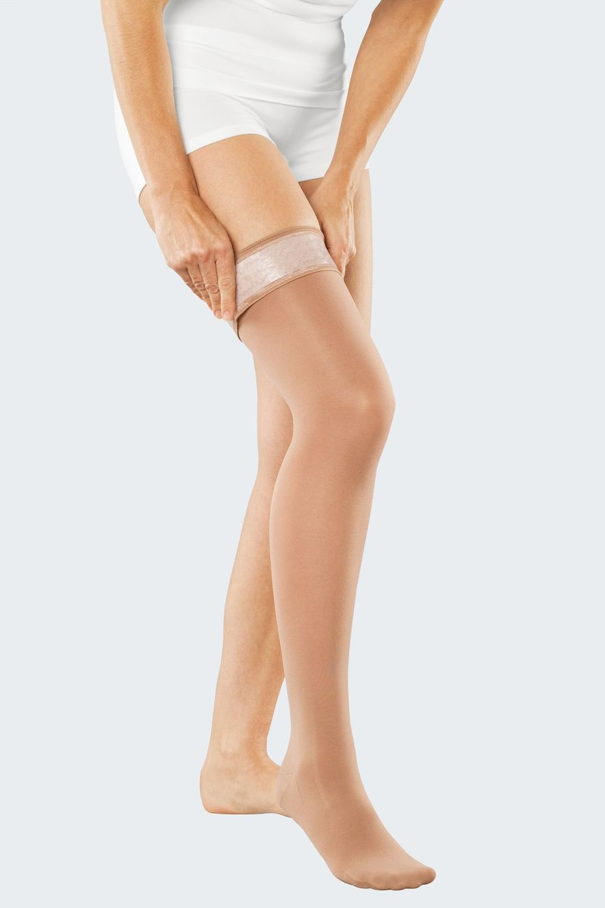 Donning compression stockings with medi Butler, step 7