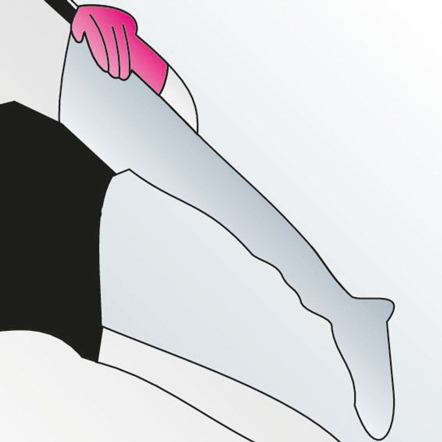 1. Reach into the compression stocking and grasp the heel.