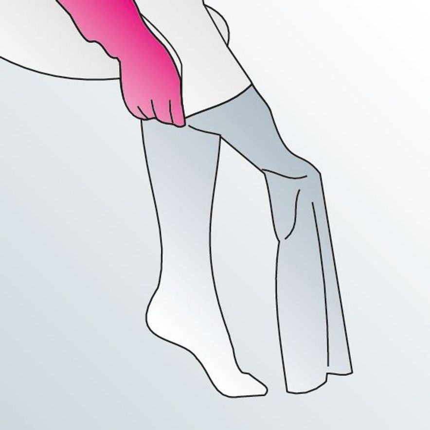 3. Pull the compression stocking over your foot to the heel.